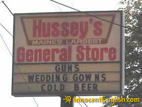 funny-store-sign-beer-guns-wedding-gowns